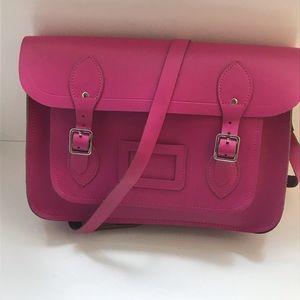 The Cambridge stachel company pink bag